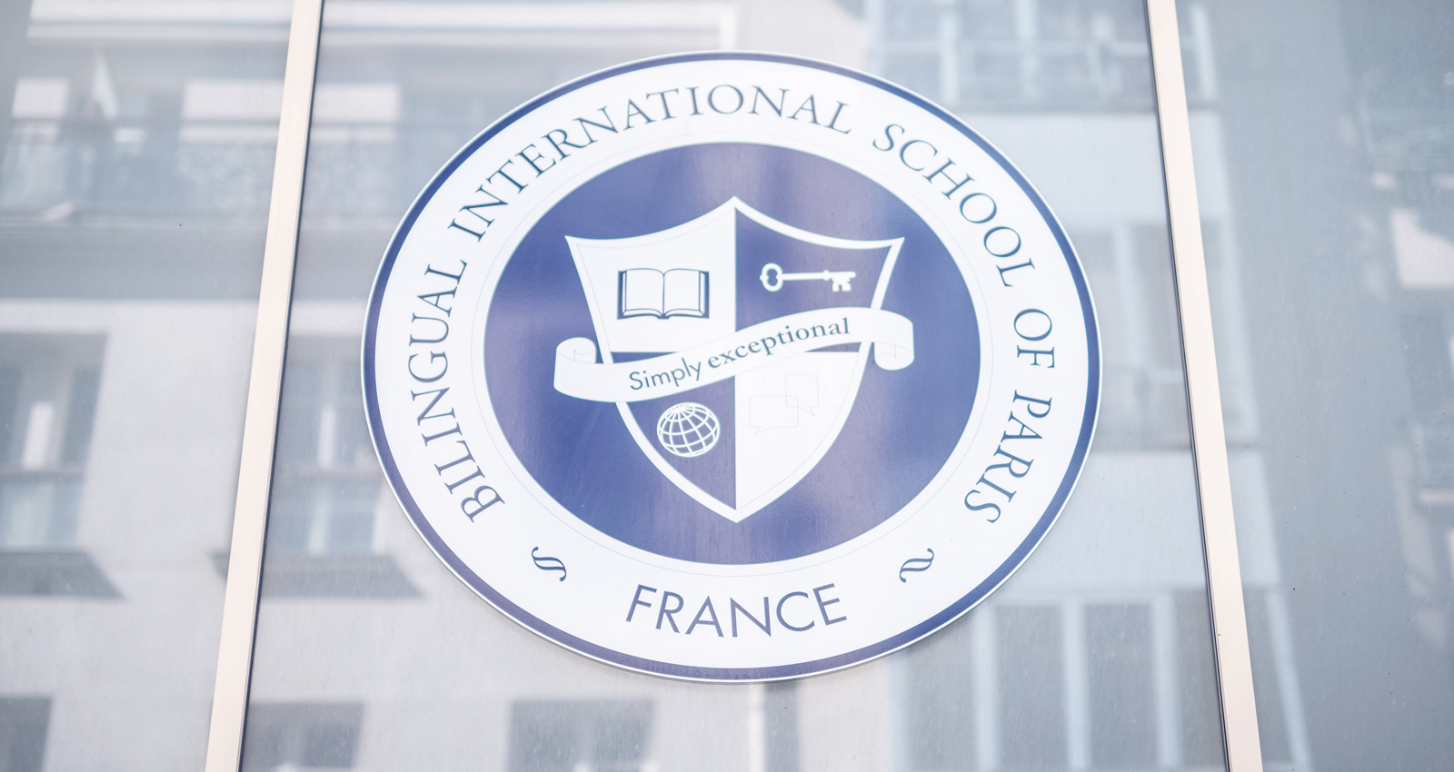 The Bilingual International School of Paris logo on the front faceda of the school