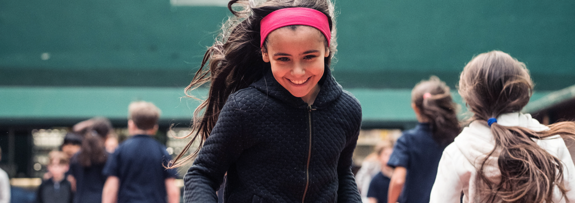 Young student of bilingual school of Paris running